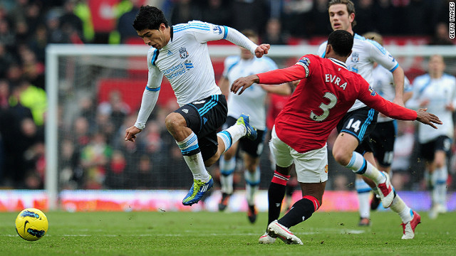 Liverpool's Luis Suarez and Man United's Patrice Evra clash on during a controversial encounter at Old Trafford on Saturday.