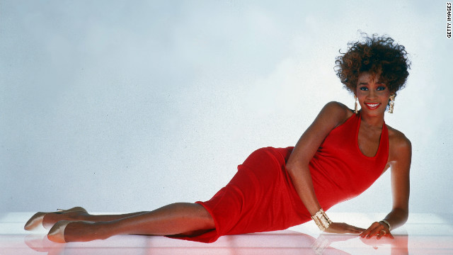 Whitney Houston strikes a glamorous pose for a photo in 1987.
