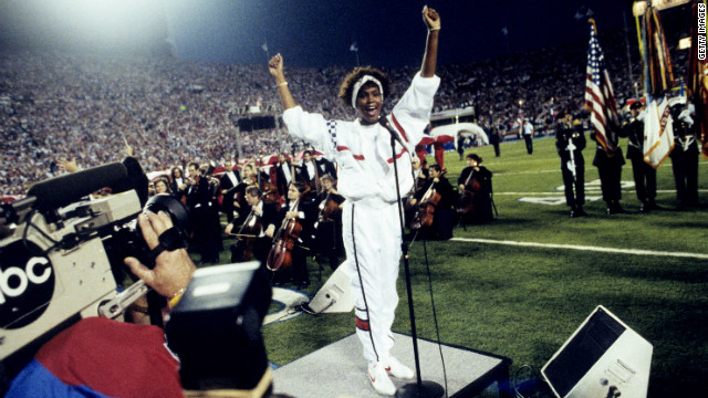 <br/>Houston gestures as she sings the national anthem before the start of Super Bowl XXV in 1991.