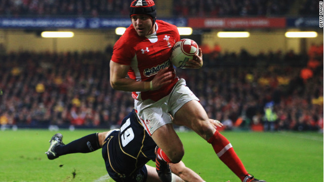 Wales full-back Leigh Halfpenny eludes a Scotland tackle to score his second try in Cardiff.