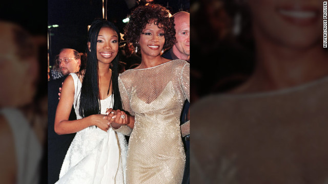 Singer-actress Brandy poses with Houston at the premiere of their made-for-television movie &quot;Cinderella&quot; in October 1997 in Hollywood.