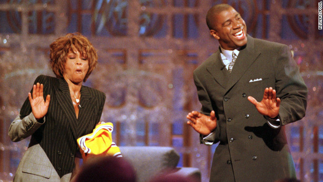 Basketball legend Magic Johnson and Houston dance during the taping of the 1998 premier of Johnson's television show, &quot;The Magic Hour,&quot; in Los Angeles. 