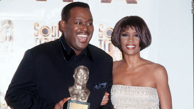Singer Luther Vandross and Houston pose for photographers in March 1999. &lt;br/&gt;&lt;br/&gt;