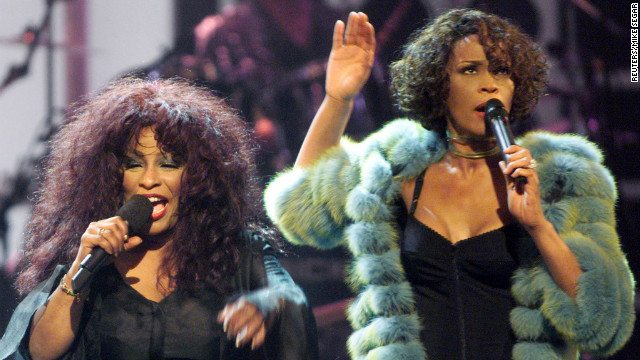 "Chaka Khan, left, and Houston perform during the VH1broadcast concert ""Divas Live 99"" at New York's Beacon Theater in 1999. The benefit concert supported VH1's ""Save the Music"" program that funds music education in public schools around the country."
