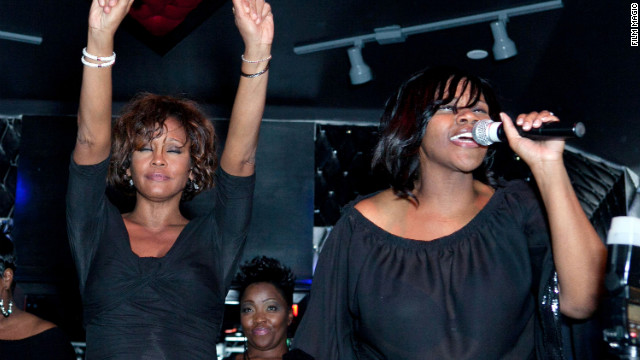 Houston and singer Kelly Price share the stage at the Kelly Price &amp; Friends Unplugged: For The Love Of R&amp;B Grammy party on Thursday, February 9, in Hollywood.
