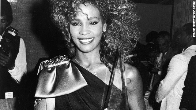 Whitney Houston poses with her American Music Award in 1986 backstage at the Shrine Auditorium in Los Angeles.