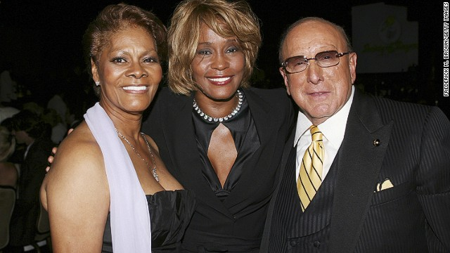<br/>Houston poses with her cousin Dionne Warwick and producer Clive Davis during the15th annual Ella Awards in Beverly Hills, California, in September 2006.