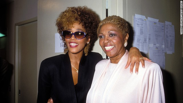 <br/> Houston poses with her mother, Cissy Houston, in March 1987.