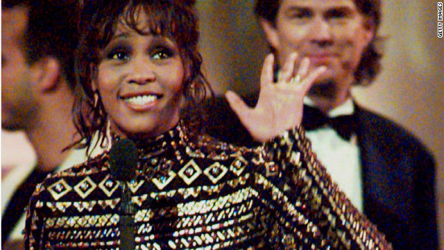 "Houston waves to the crowd at the 36th Annual Grammy Awards in New York in March 1994, after she was honored for Record of the Year, ""I Will Always Love You,"" and Album of the Year, the soundtrack from the film ""The Bodyguard."""