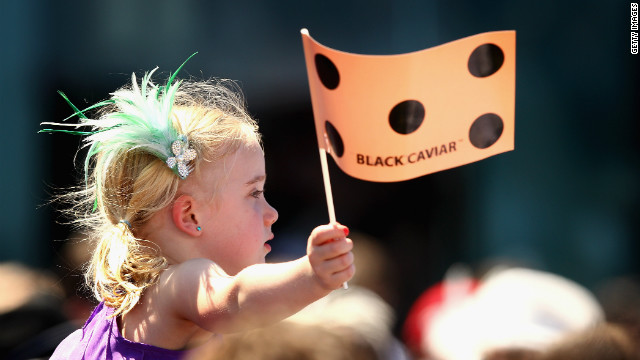 The horse has fans of all ages, with this little girl waving a Black Caviar flag during her Orr Stakes win on Saturday.