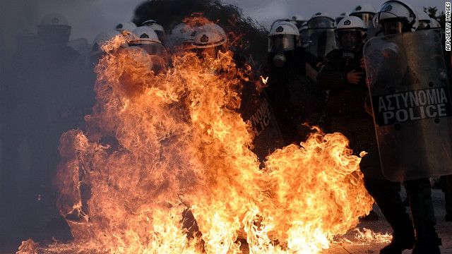 Riot police are engulfed by flames during clashes with protestors in Athens on February 12, 2012.