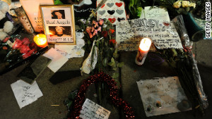 Whitney Houston fans share their feelings at a remembrance outside the Beverly Hilton Hotel in Los Angeles on Monday.