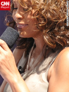 "<a href='http://ireport.cnn.com/docs/DOC-746558'>Asterio Tecson</a> was in New York's Central Park in September 2009, testing out his new Nikon D700 and telephoto lens. He saw that Whitney Houston was performing as part of Good Morning America's Summer Concert Series, and he got into the show. So many people were trying to get close to the stage that it was ""utterly impossible to steadily hold the long lens when Whitney sang her hit singles!"" Tecson says. ""Whitney was just so raw and stood proud, oozing with confidence."""