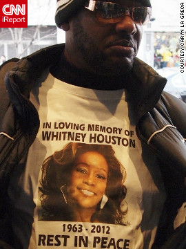 "The day after Houston was found dead at a Beverly Hills hotel, fans left flowers and notes outside New York's Apollo Theater, where she filmed one of her first music videos. One fan wore a T-shirt in her memory. New Jersey photographer <a href='http://ireport.cnn.com/docs/DOC-747770'>Caryn La Greca </a> says she ""felt sorrow for the young singer who lost her life so young."""