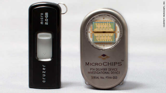 The drug delivery device (on right) is shown next to a computer flash drive.