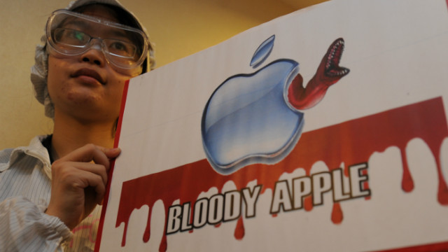 A protester takes part in a rally last year in Hong Kong against Foxconn, which makes Apple products.