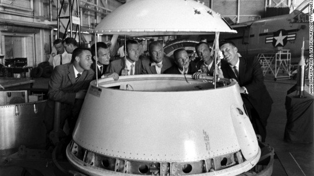 The original Mercury 7 astronauts inspect an early design of a space module. From left are Gus Grissom, Deke Slayton, Gordon Cooper, John Glenn, Scott Carpenter, Alan Shepard and Wally Schirra. In 1962, Glenn was the first American to orbit the Earth. <a href='http://life.time.com/history/john-glenn-unpublished-photos/#1' target='_blank'>See more images at Life.com</a>