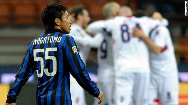 Inter's Yuto Nagatomo looks on as Bologna celebrate their second goal at the San Siro.