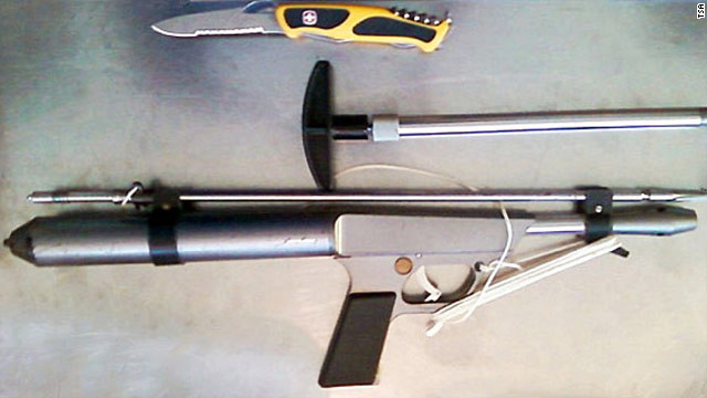 TSA released a picture of a spear gun and utility knife that a traveler tried to take on board an airplane.