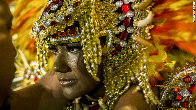 A dancer prepares before participating in the opening night of parades at the Sambadrome in Sao Paulo.