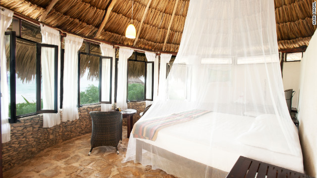Go to sleep to the sound of waves lapping near your beachfront cabana at Maya Tulum.