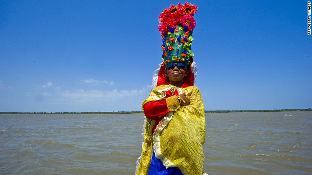 A boy dressed in a traditional costume poses before the start of the second-day parade in Barranquilla, Colombia, on Sunday.