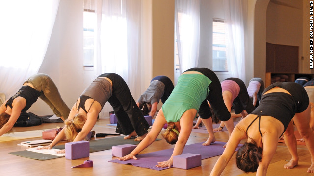 Participants in an afternoon yoga class at Kripalu practice downward facing dog. <br/><br/>
