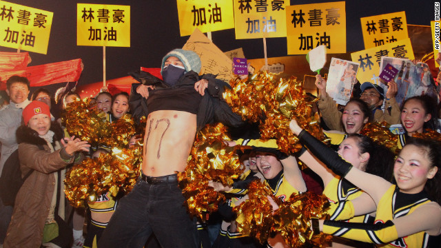 Fans of NBA basketball player Jeremy Lin celebrate in his family's hometown of Changhua, Taiwan, on Friday.