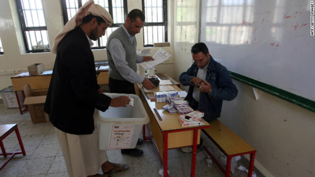 Yemeni election committee members prepare ballot boxes in Sanaa on Monday, the eve of the country's presidential election.