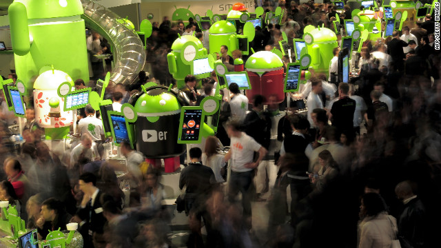 Participants throng around exhibits at the 2011 Mobile World World congress in Barcelona.