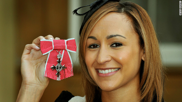 Ennis proudly shows off her Member of the Order of the British Empire medal (MBE) awarded by the UK's Queen Elizabeth for services to athletics.