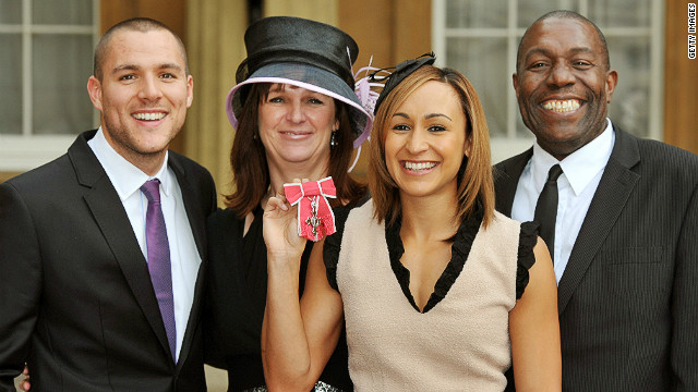 Ennis with her fiancee Andy Hill (left) and parents Alison and Vinny at Buckingham Palace, London in November 2011.