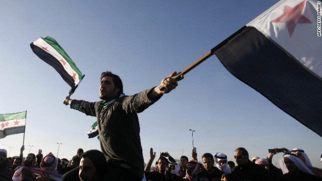 Kuwaitis and Syrians protest the Syrian bloodshed February 4 outside the Syrian embassy in Kuwait City.
