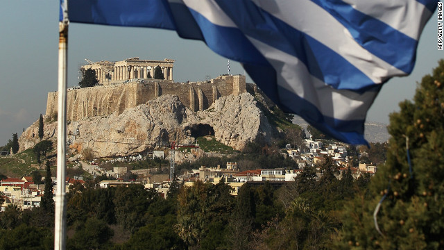 The Greek flag flies in front of the Parthenon on the Acropolis on February 17, 2012 in Athens, Greece. 