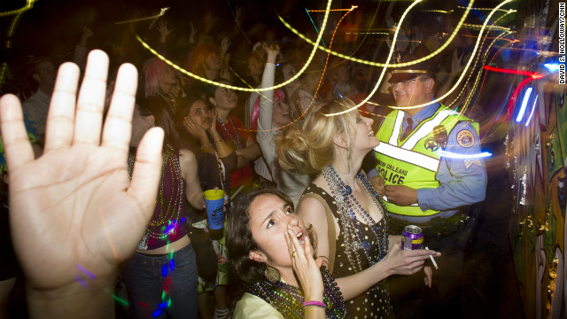 "This lively Mardi Gras scene depicts what many think of when they hear ""New Orleans."" Chaos and alcohol define the mood, with police standing by."