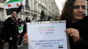 An anti-Syria regime demonstrator in Paris remembers journalists killed in Syria Wednesday.