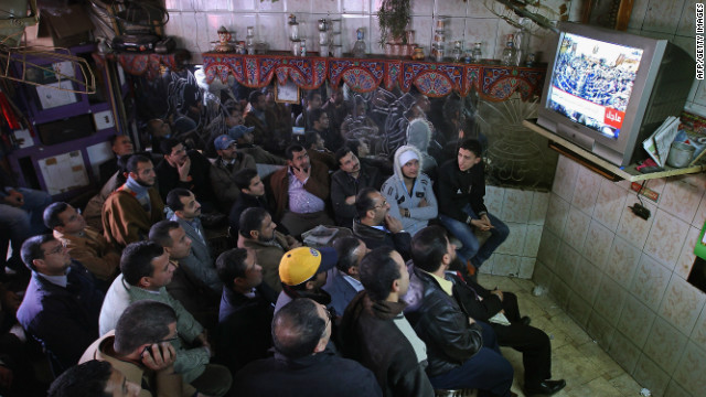 Now, in neighborhood cafes across Cairo, men tune in to daily political talk shows discussing Egypt's own crisis and fears for the future.