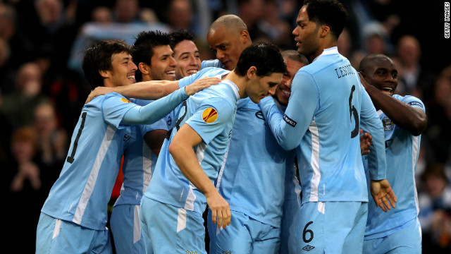 Manchester City players celebrate Sergio Aguero's opener in the 4-0 win over Porto at the Etihad Stadium