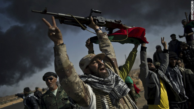Last year he spent time in Libya, covering the efforts of rebel fighters during the country's civil war. Here he captured them singing and celebrating on a road just outside the strategic oil town of Ras Lanouf.