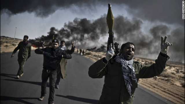 Ochlik was born in eastern France, and studied photography in Paris, before setting up his own picture agency, IP3 PRESS.<br/><br/>Photo: Libyan opposition fighters go to the front line, armed with RPGs and flashing victory signs, outside Ras Lanouf .