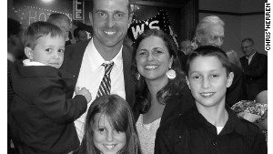 Herren is shown with his wife of 14 years, Heather, and their three children.