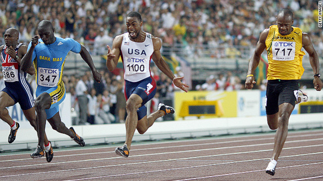 But Gay stormed to gold in the 100m, beating Derrick Atkins of the Bahamas (left) and Jamaica's Asafa Powell in a time of 9.85 seconds. 