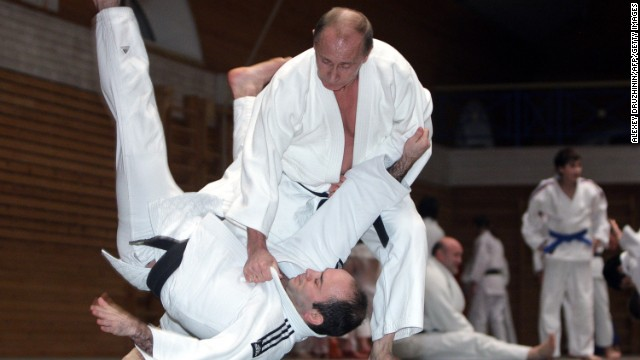 Famed for his love of martial arts, Putin throws a competitor in a judo session at an athletics school while on a trip to St. Petersburg on December 18, 2009.
