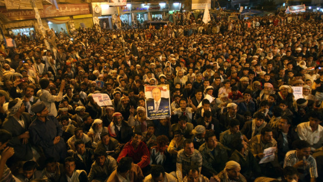Yemeni anti-government protesters celebrate the end of the regime of President Ali Abdullah Saleh in Sanaa, February 22, 2012.