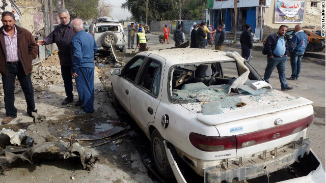 Iraqis inspect the damage after an explosion in central Baghdad on Friday.