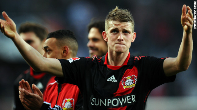 Bayer Leverkusen's two-goal hero Lars Bender celebrates after Saturday's win over Cologne.