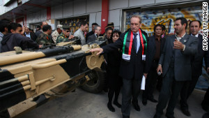 French defense minister Gerard Longuet, center, visits the War Museum on Sunday, in Misrata.