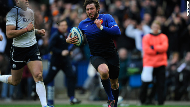 Maxime Medard runs clear of the Scotland defense to score his try in France's 23-17 win.