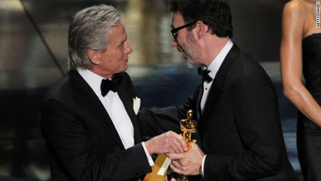 Michel Hazanavicius accepts the Best Director award for