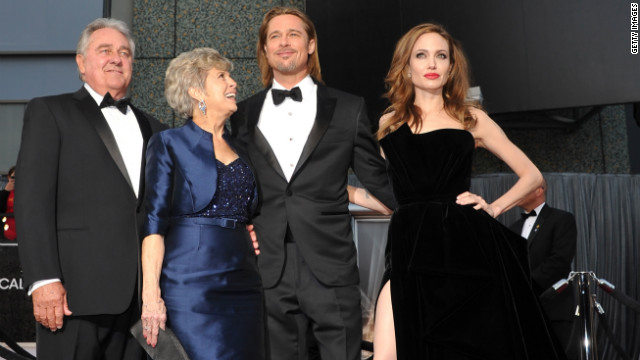 The Oscars were a family affair for Brad Pitt, center. Along with Angelina Jolie, right, who presented during the ceremony, Pitt brought his parents, <a href='http://www.accesshollywood.com/brad-pitt-and-angelina-jolie-bring-brads-parents-to-oscars_article_61201?cnn=yes' target='_blank'>Jane and Bill Pitt</a>.